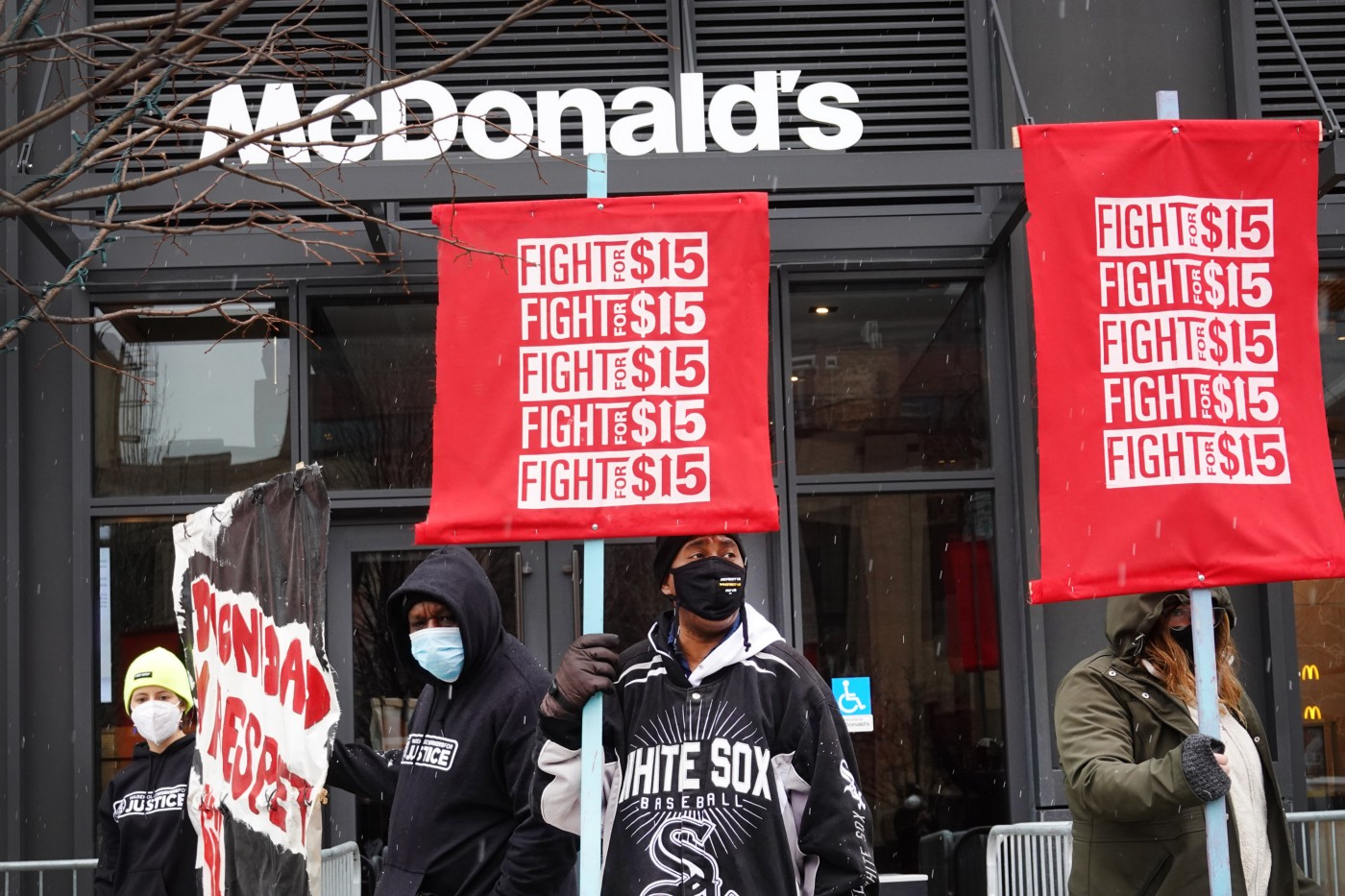 Demonstrators participate in a protest outside of McDonald's corporate headquarters on January 15, 2021 in Chicago, Illinois.