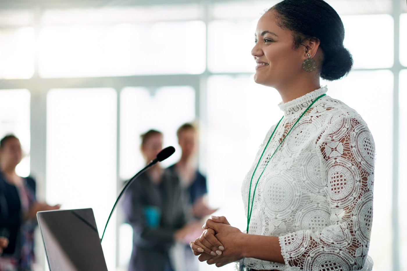 A young businesswoman confidently delivers a presentation at a conference