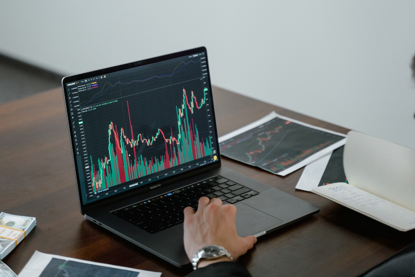 Person checking stock price on computer.
