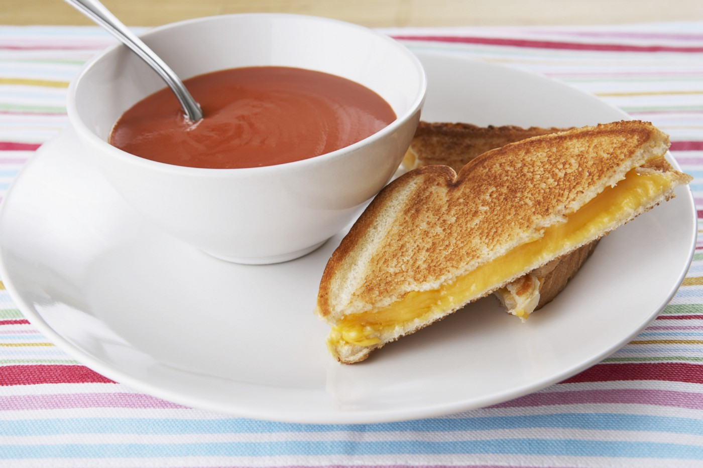 Grilled cheese sandwich and tomato soup.