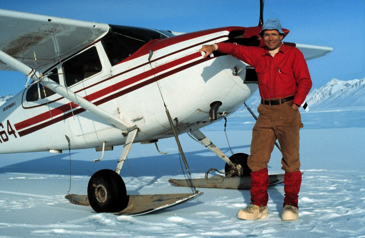 Francis Mauer with a single engine aircraft on skis by USFWS
