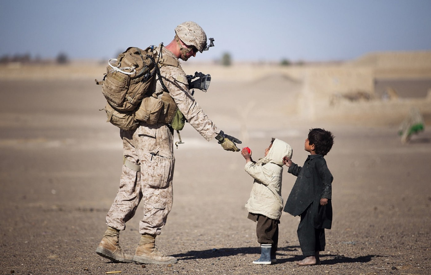US soldier interacting with Afghan children