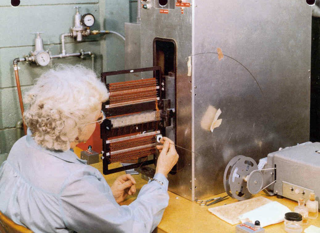 a woman weaves wire to create core rope memory