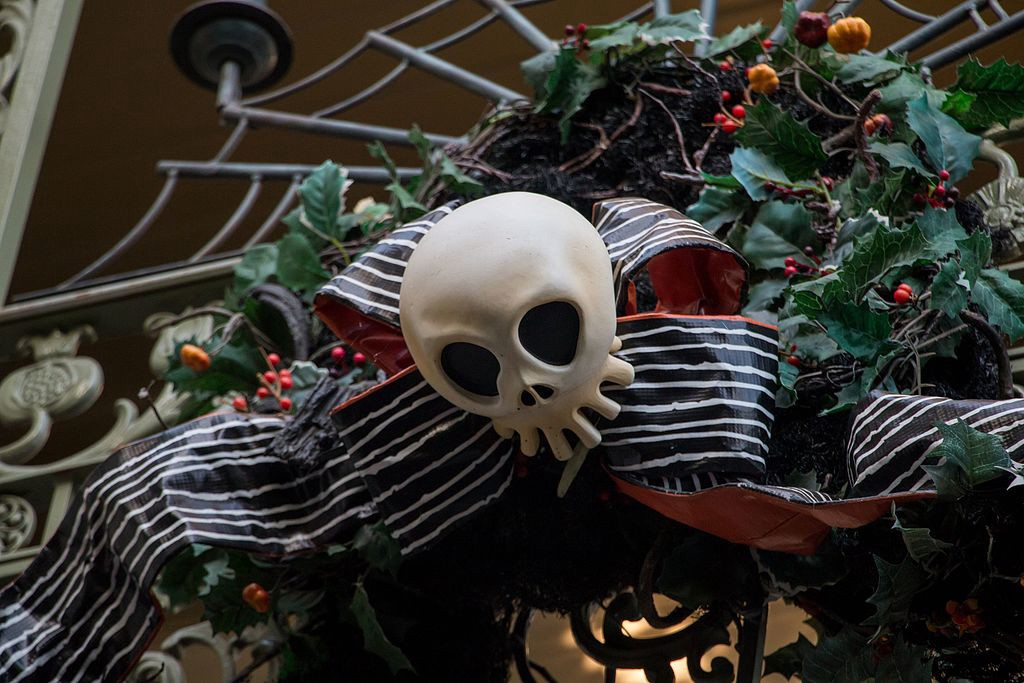 Halloween decoration with skull, bow, holly, spider web