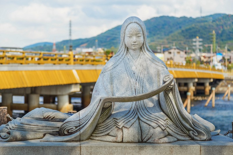 A statue of Murasaki Shikibu along the Uji River in Kyoto