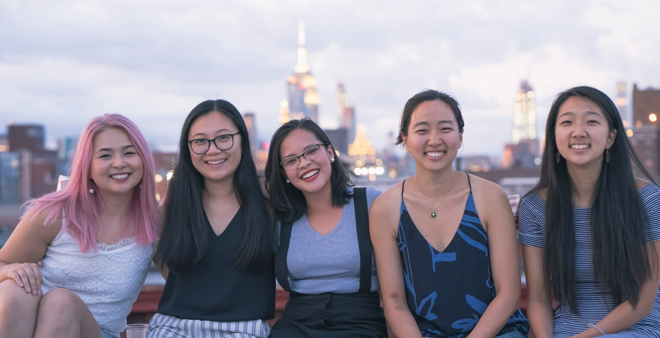 Photo of 5 Asian American women in front of the NYC skyline