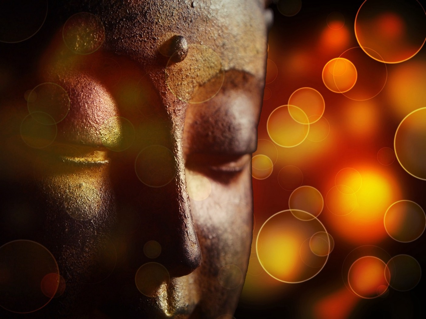 face of a sculpture of the Buddha meditating