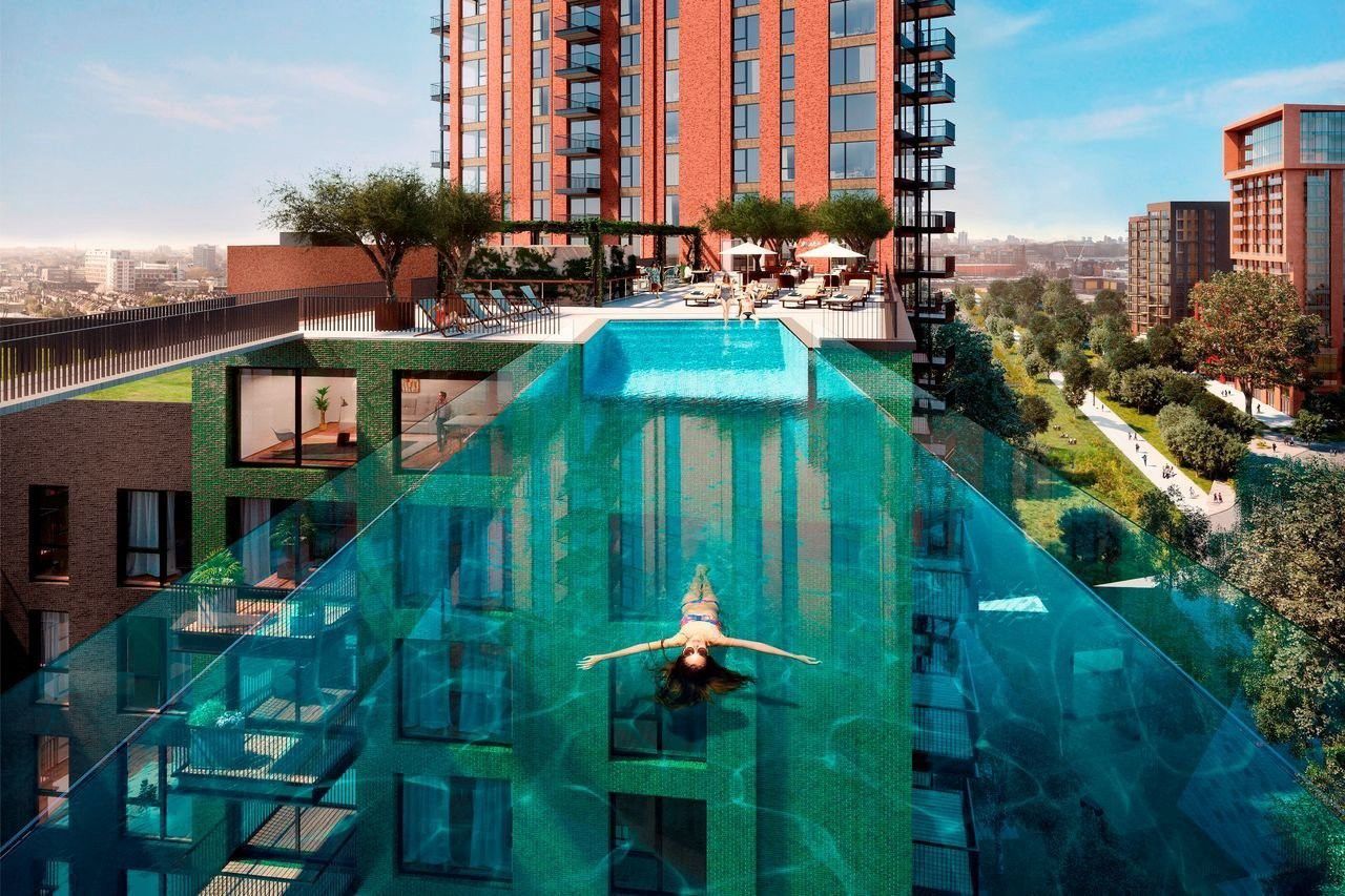 We're looking at a rooftop pool like no other. It's made entirely of see-through plastic. It spans the distance between two neighbouring buildings, like a bridge made of water. There's a woman in the pool, floating on her back. If she were to look down, she'd be able to see the ground, hundreds of feet below her.