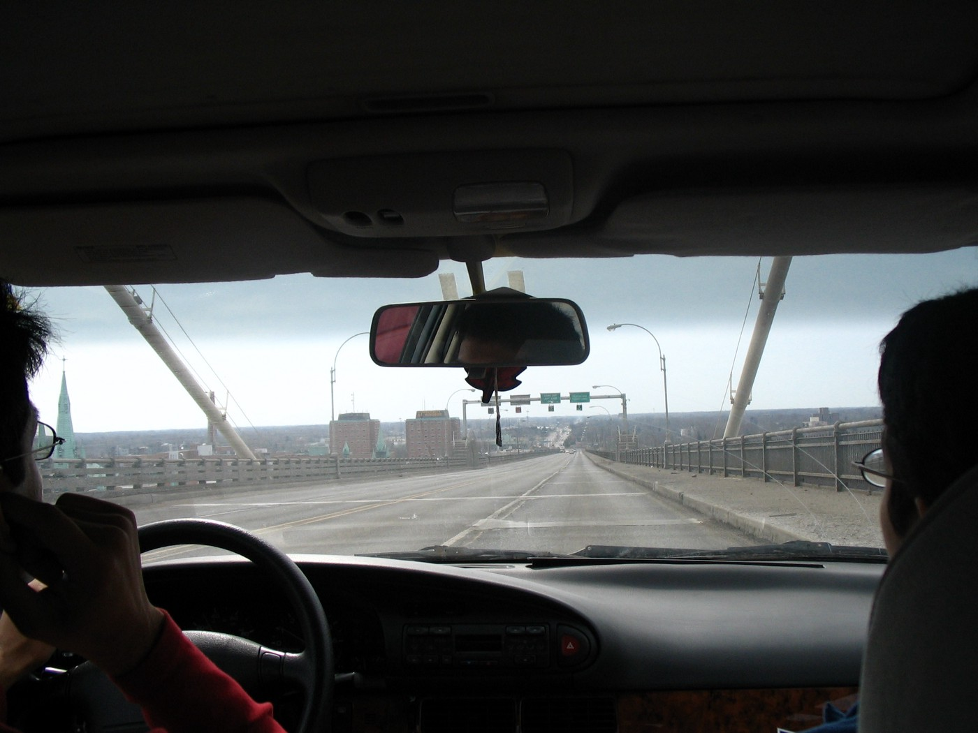Car interior, looking out onto a bridge and cityscape