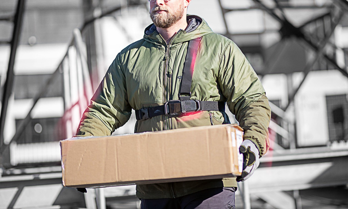 Essential worker wearing the FUSE in order to stay safe while on the job.