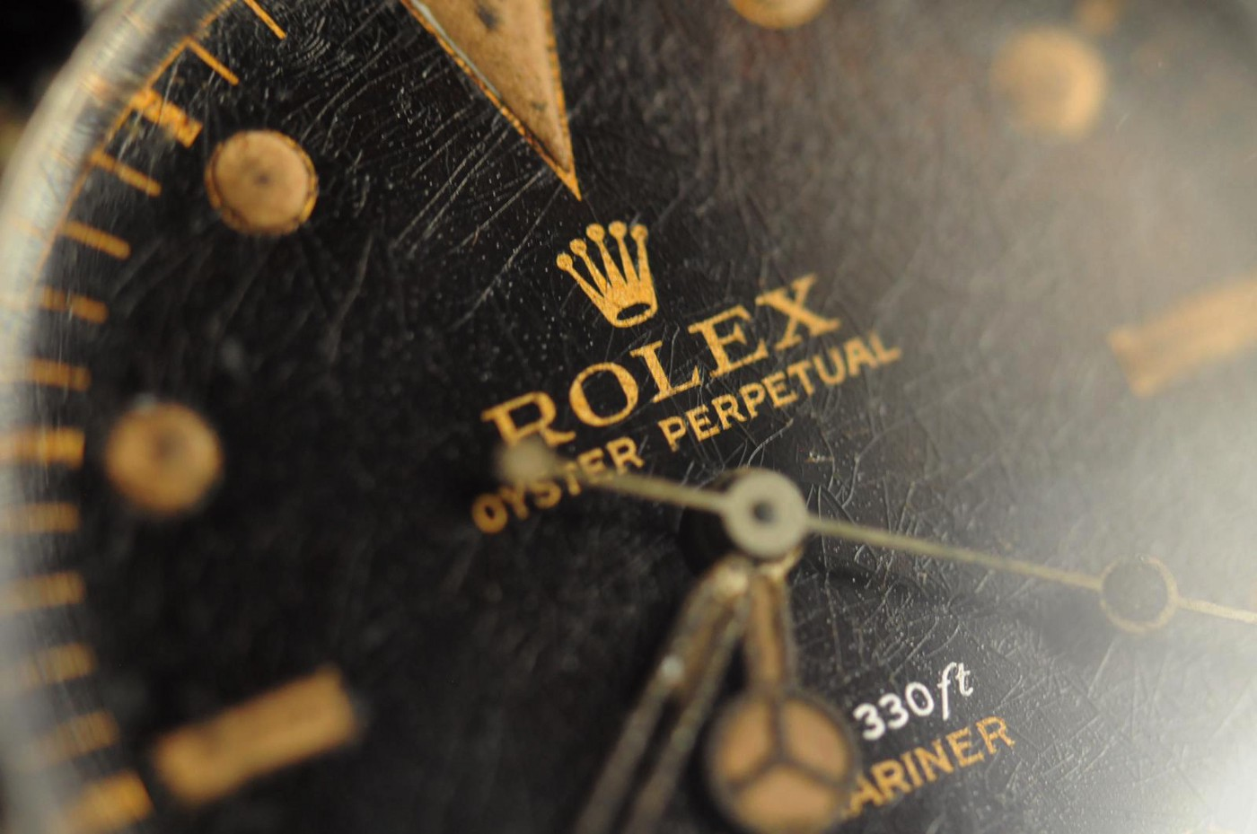 Old Rolex dial macro with gilt logo and spider (cracked) texture