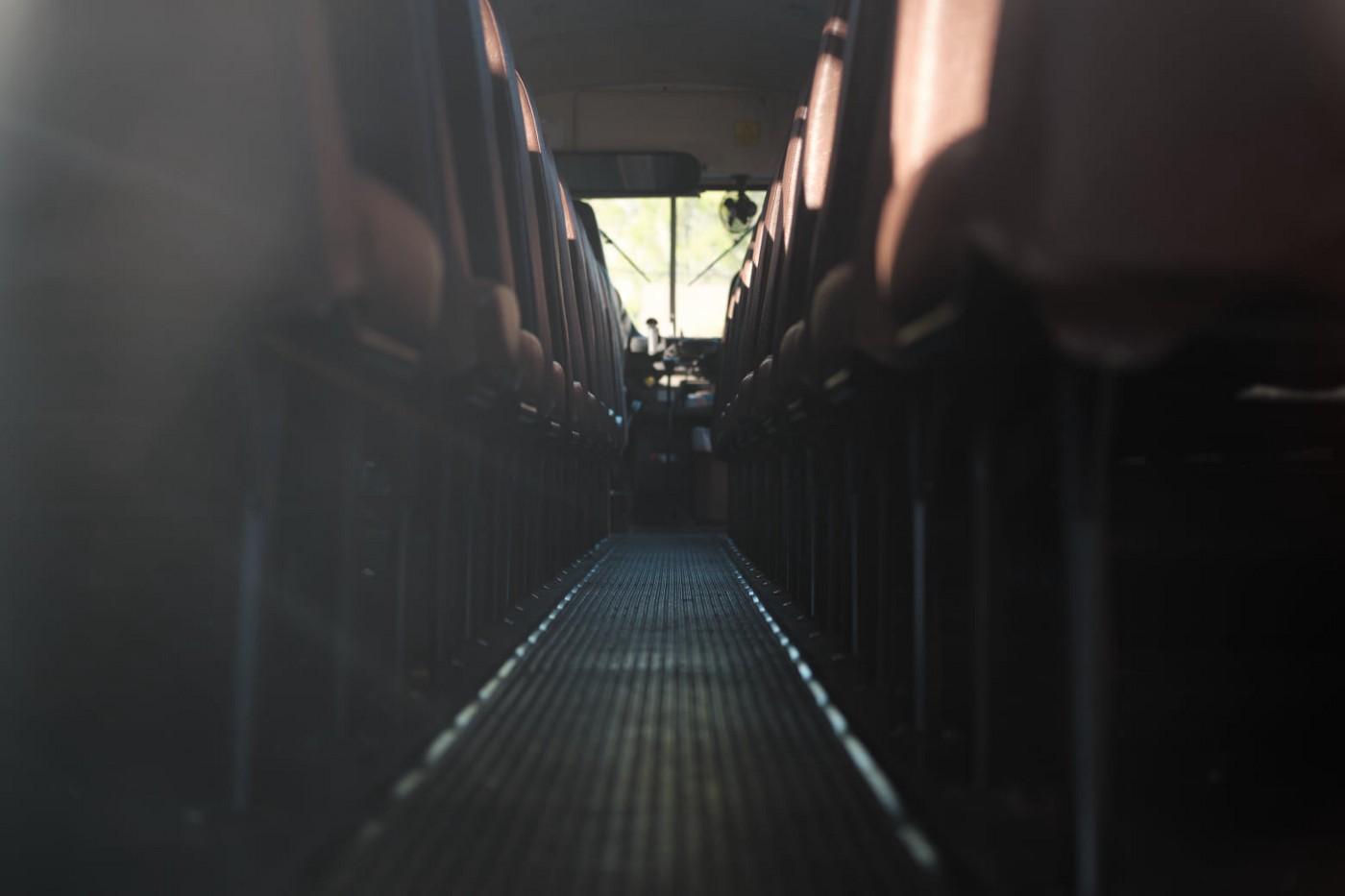 Staring down the aisle of a school bus