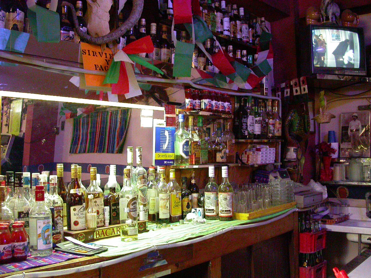 a bar stocked with liquor bottles