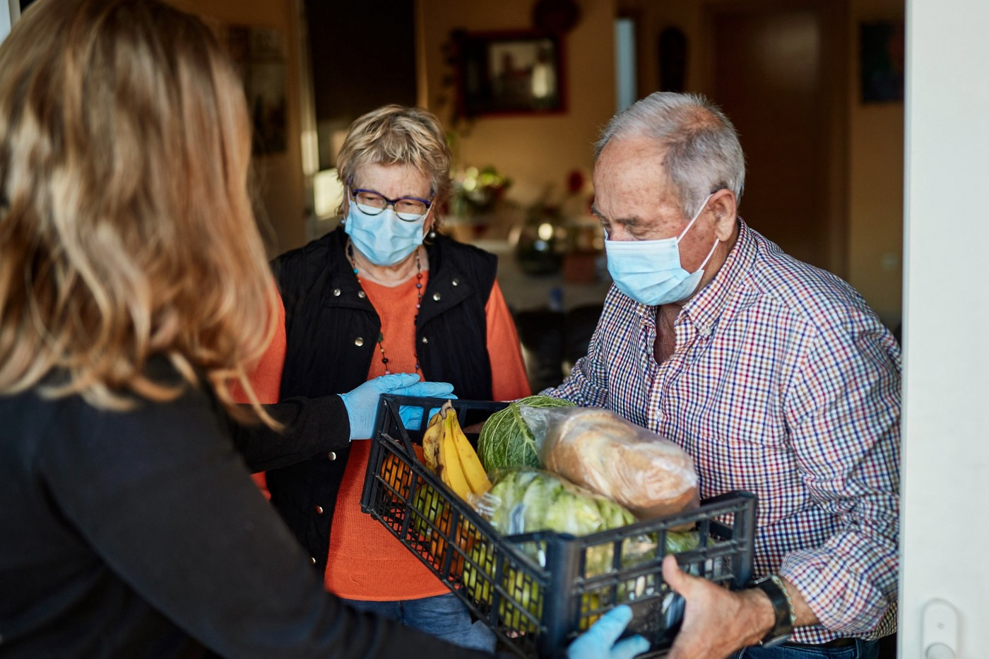 Couple receives groceries at home during quarantine.