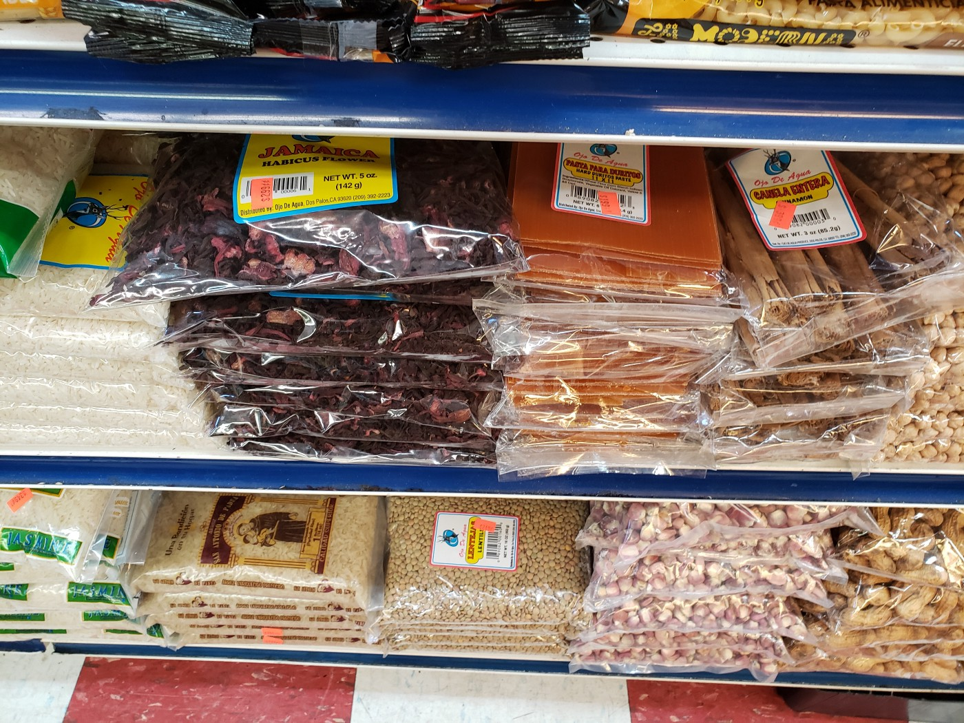 Dried goods: jamaica (hibiscus), durito sheets, cinnamon sticks, rice, hominy and peanuts at E. 14th Produce