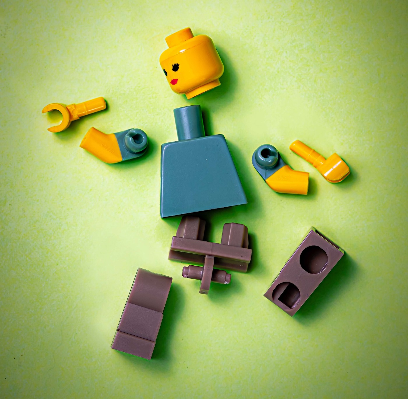 Lego piece in pieces. Metaphor for your brain. Boom.