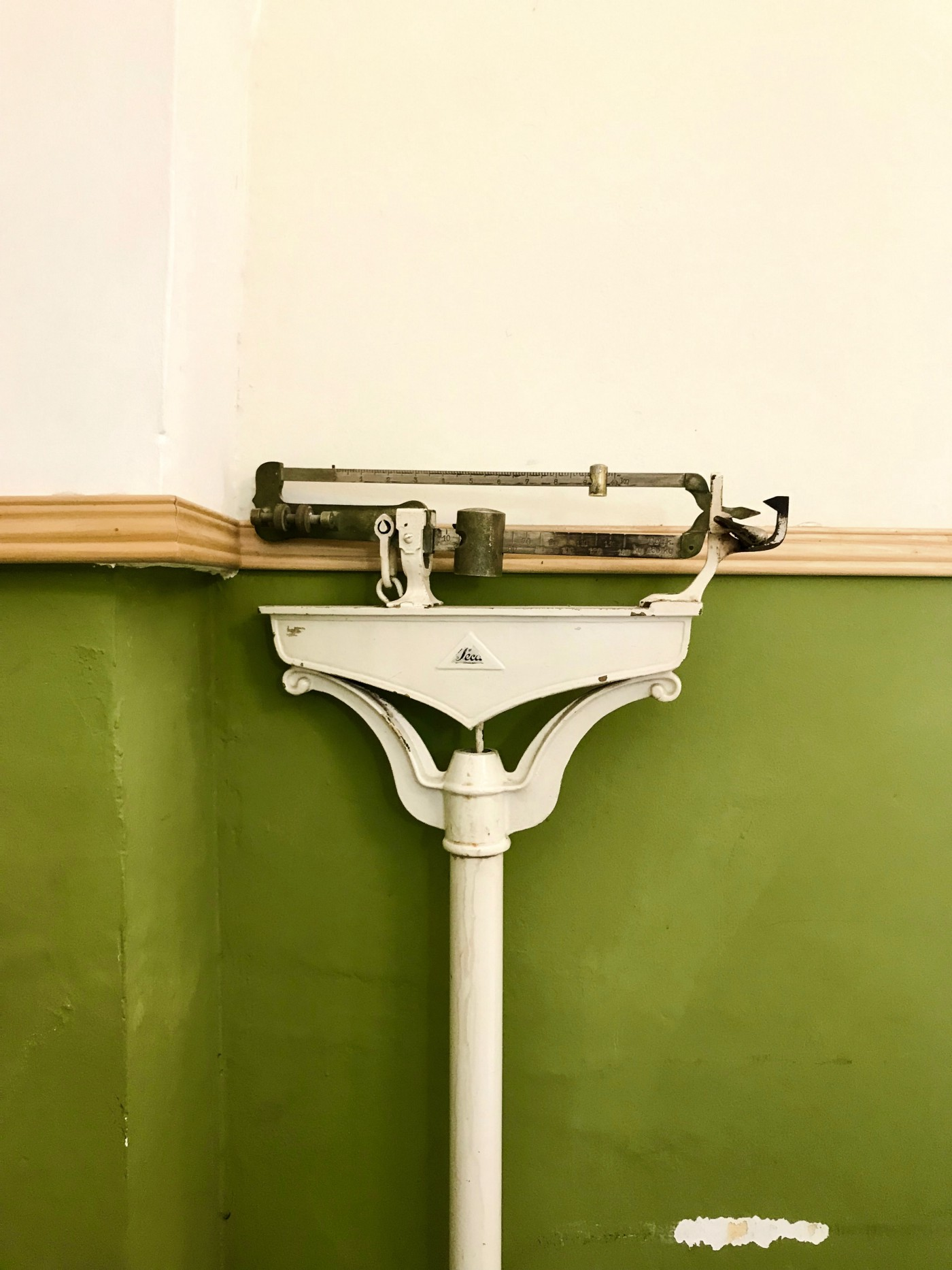 old fashioned antique doctor weighing balance scales