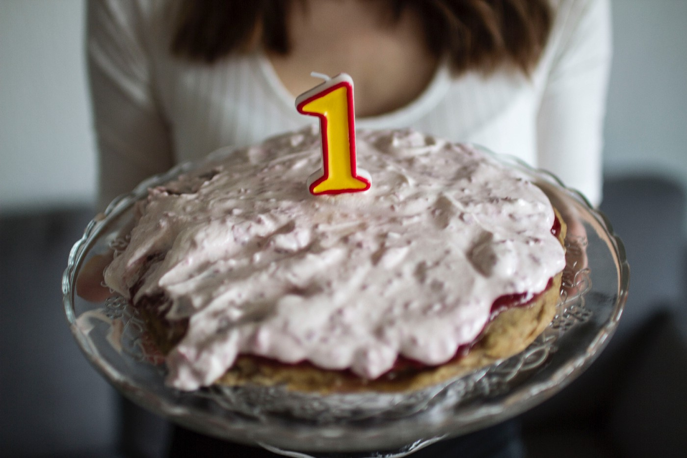 Birthday cake with candle in the form of the number one