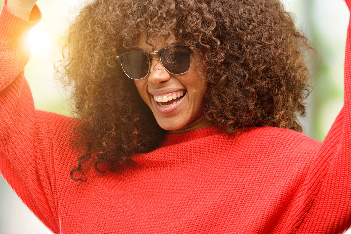 Happy encouraging woman in red sweater
