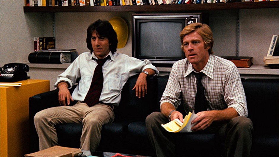 Still from the movie All the President's Men. Dustin Hoffman and Robert Redford sitting on a couch.