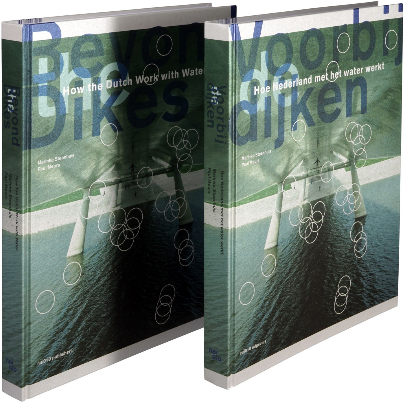 Photo of the greenish book cover diagonally stood-up showing the English cover on the left and the Dutch version on the right