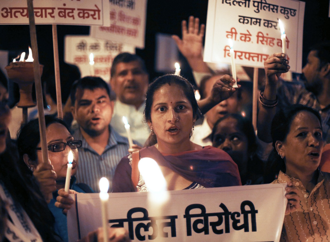 A photo of Indian protestors holding a candlelight march.