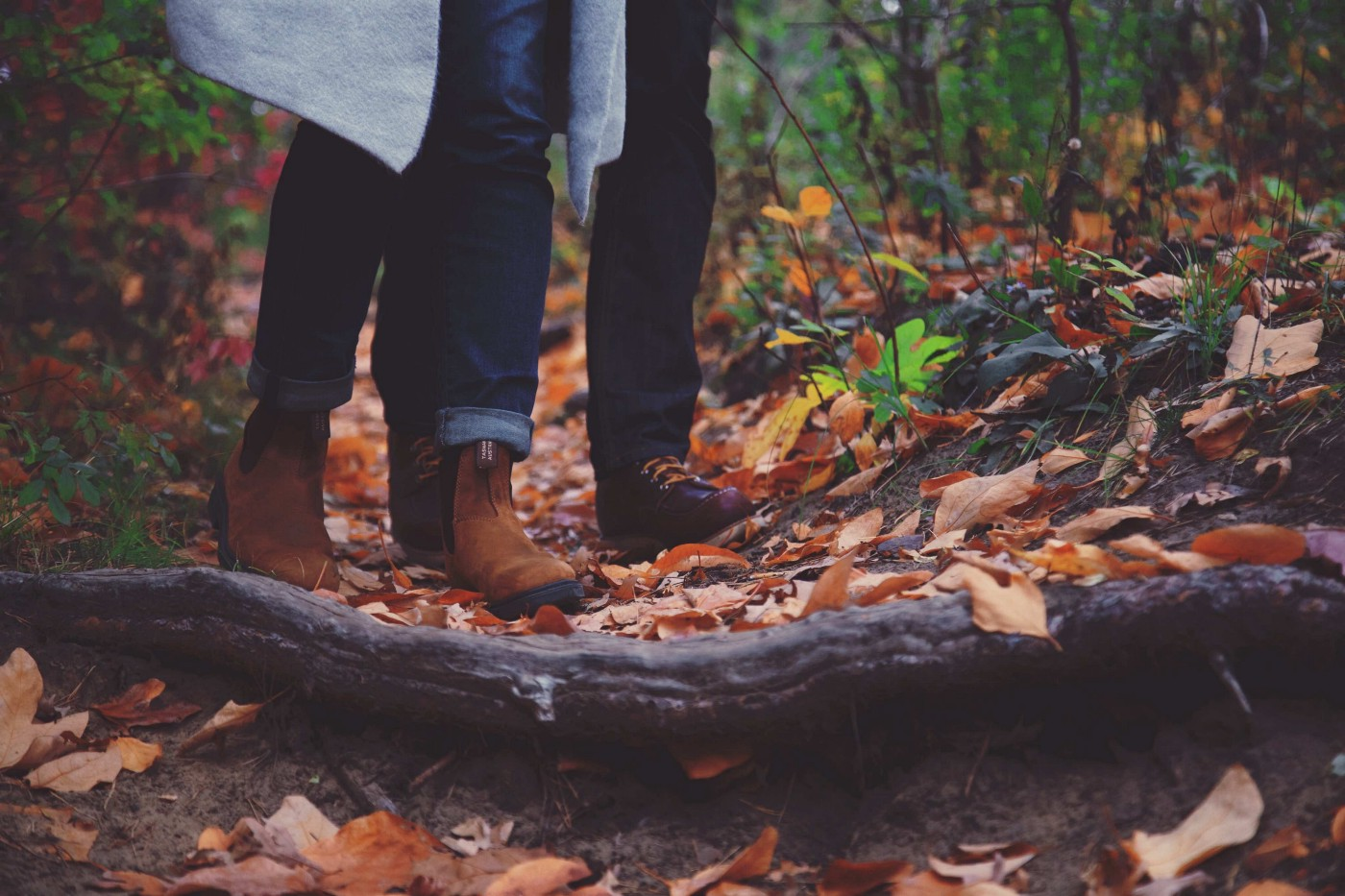 two pairs of boots, walking together in the forest