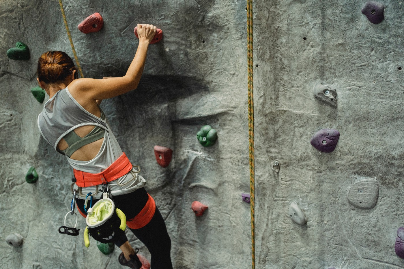 Unidentified person going up a climbing wall.