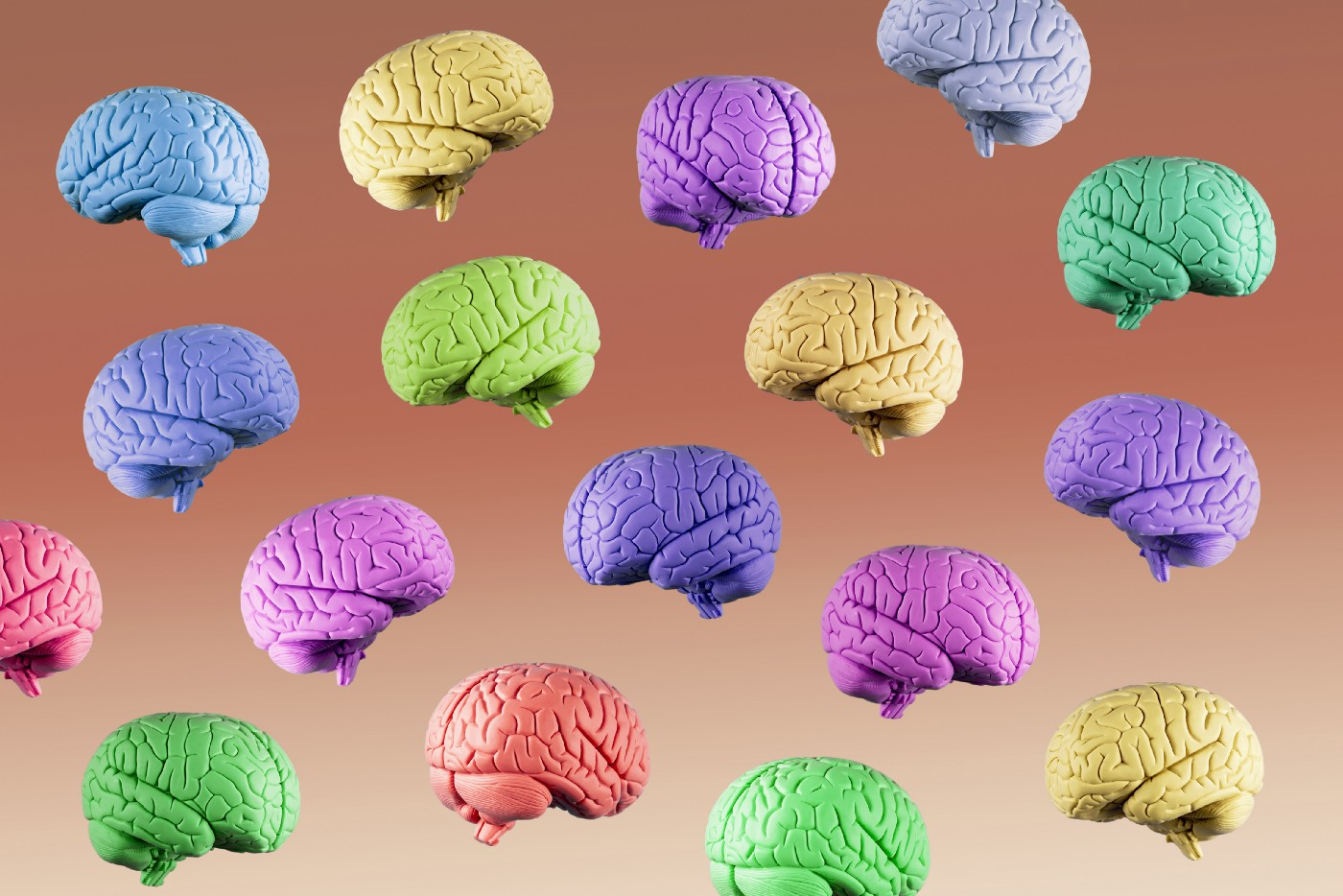 Multicolored blue, green, yellow, purple, and orange human brains floating mid air on a gradient brown background.