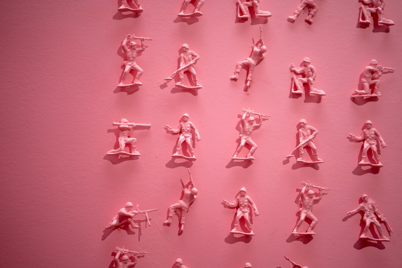 Pink army men on a pink background