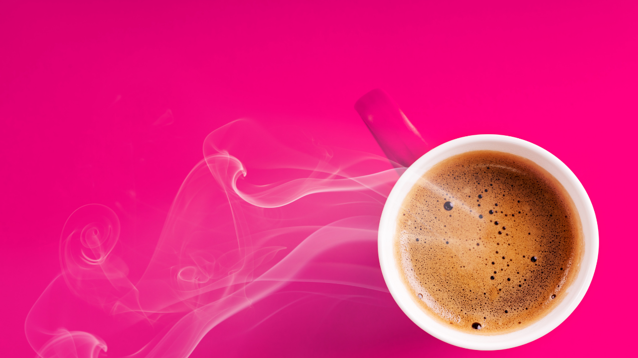 Pink table with a top-down view of a steaming cup of coffee, for I tried sex-coffee—Here's what happened.