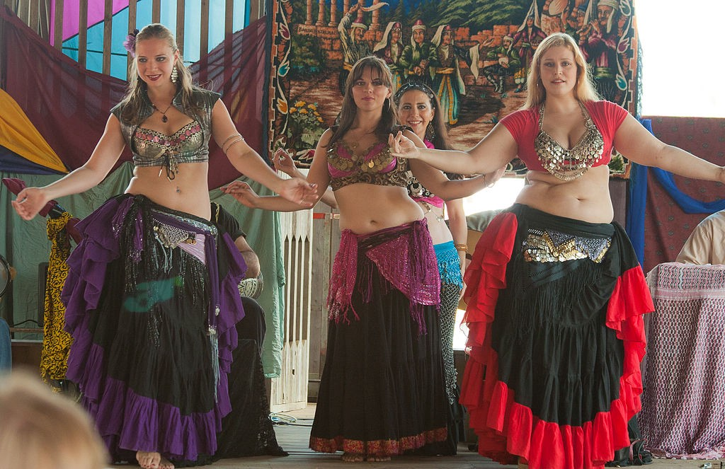 Three belly dancers performing at an event in Minnesota.