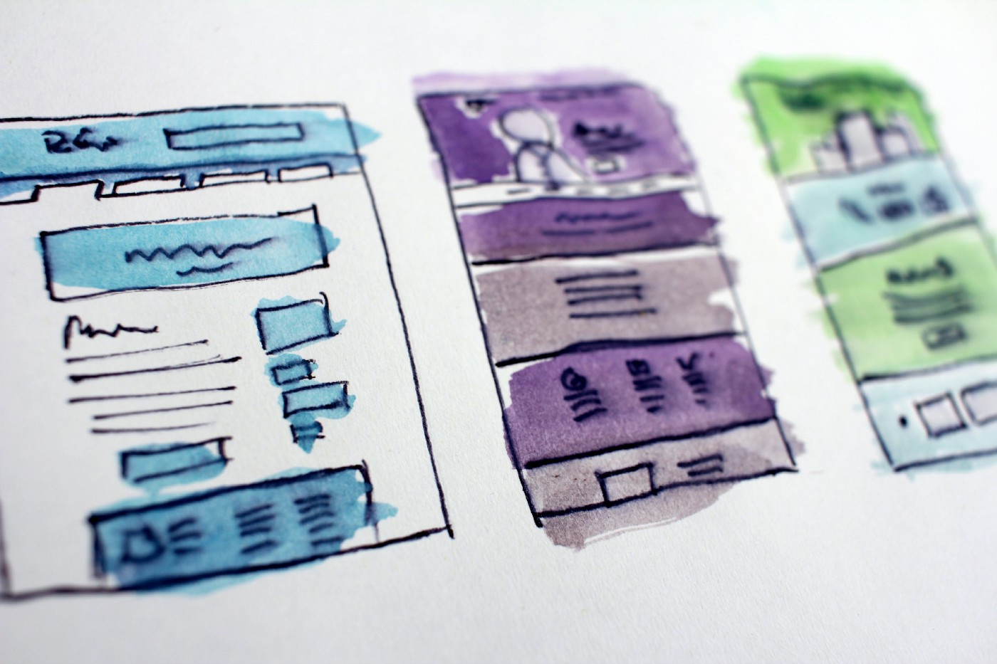 Hand-drawn wireframes watercolored in blue, purple, and green