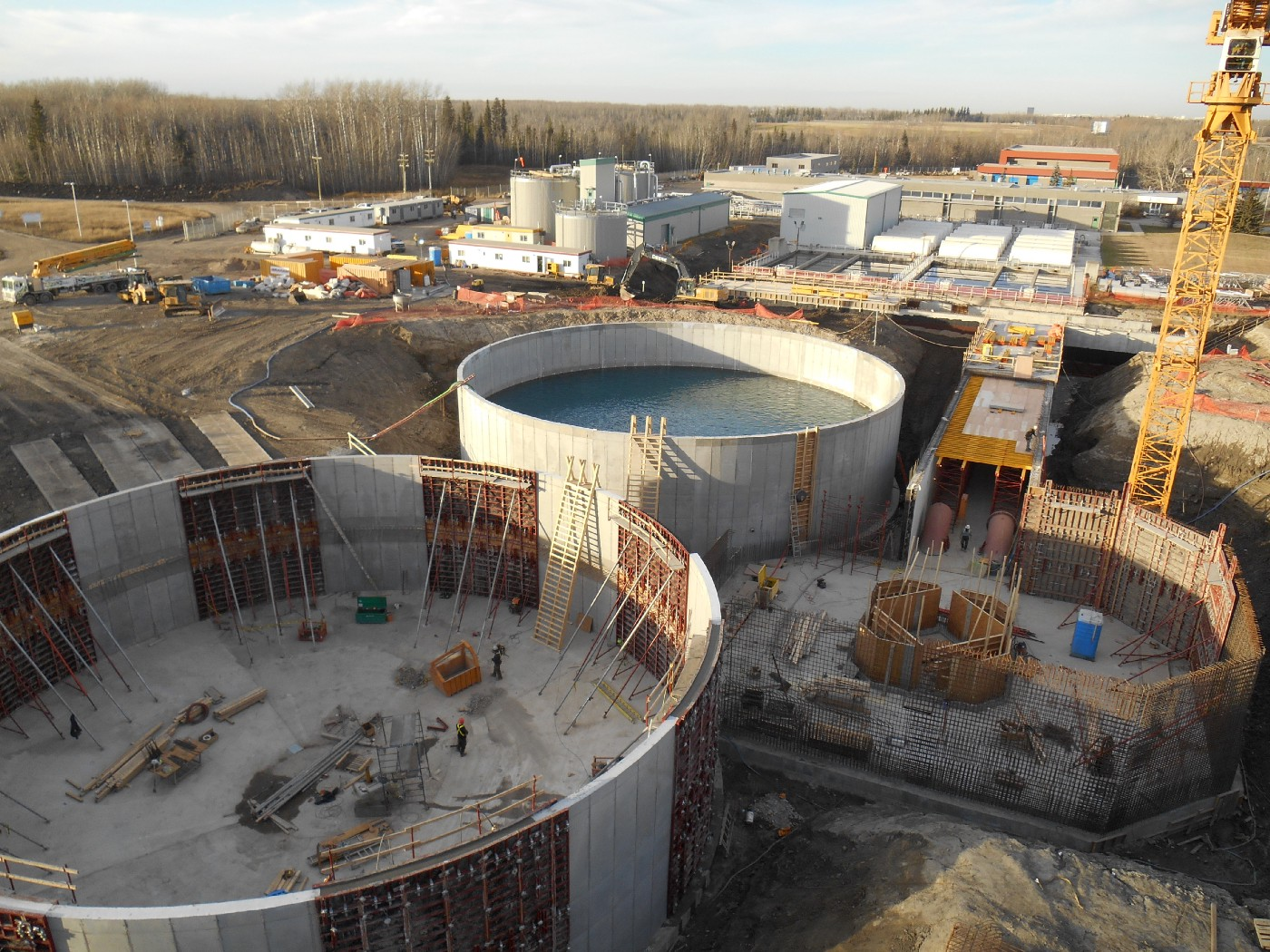 Two tanks belonging to Aquatera's water plant stand side by side near partially constructed structures.