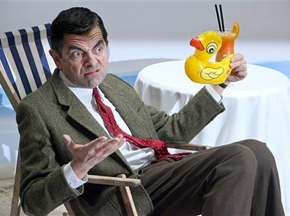 Mr. Bean shrugging and holding a duck.