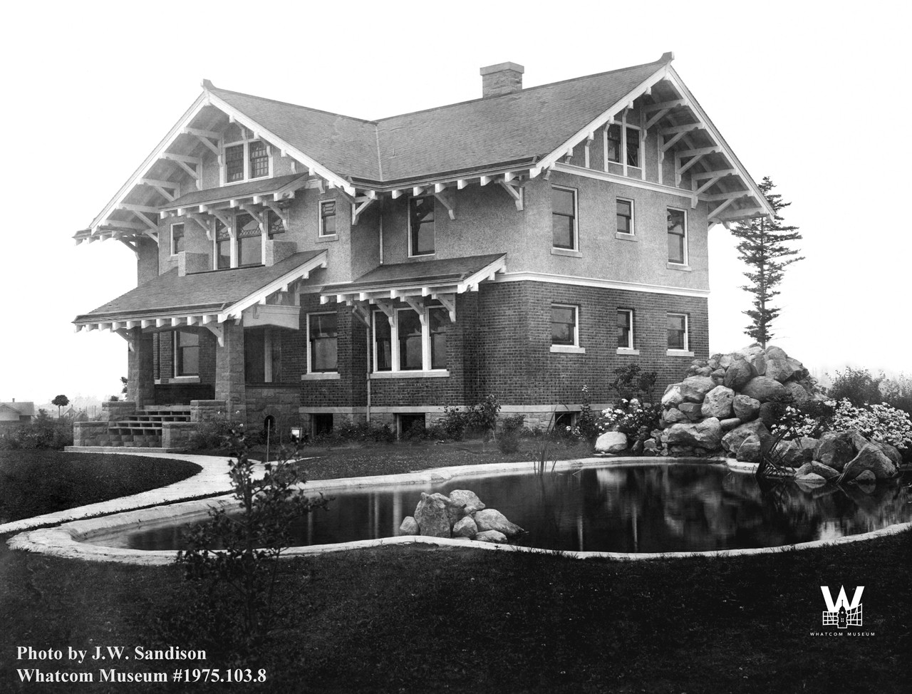 old, black and white photo of the Roeder Home with pond in the front yard