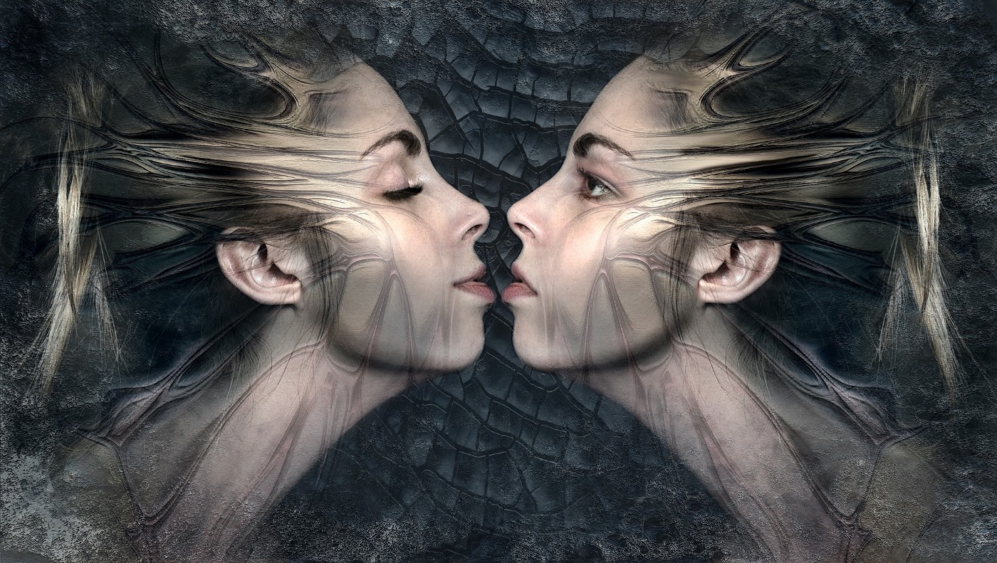 Profiles of female twins facing each other, one with her eyes open the other with her eyes closed.