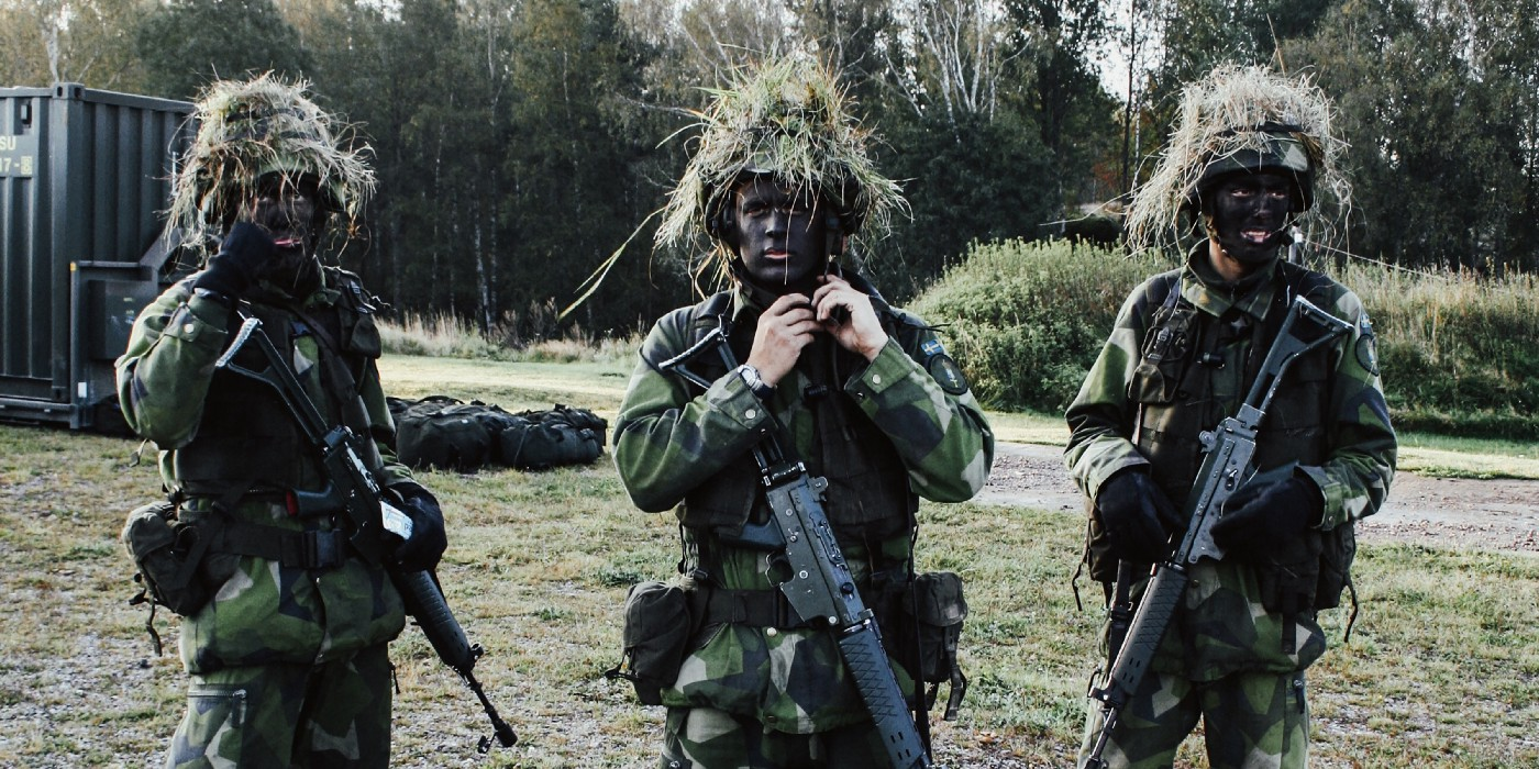 An image of three soldiers at a training bootcamp, intended to be a play on words with coding bootcamp.