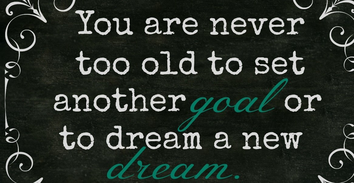 "Words on blackboard: ""You are never too old to set another goal or dream a new dream."""