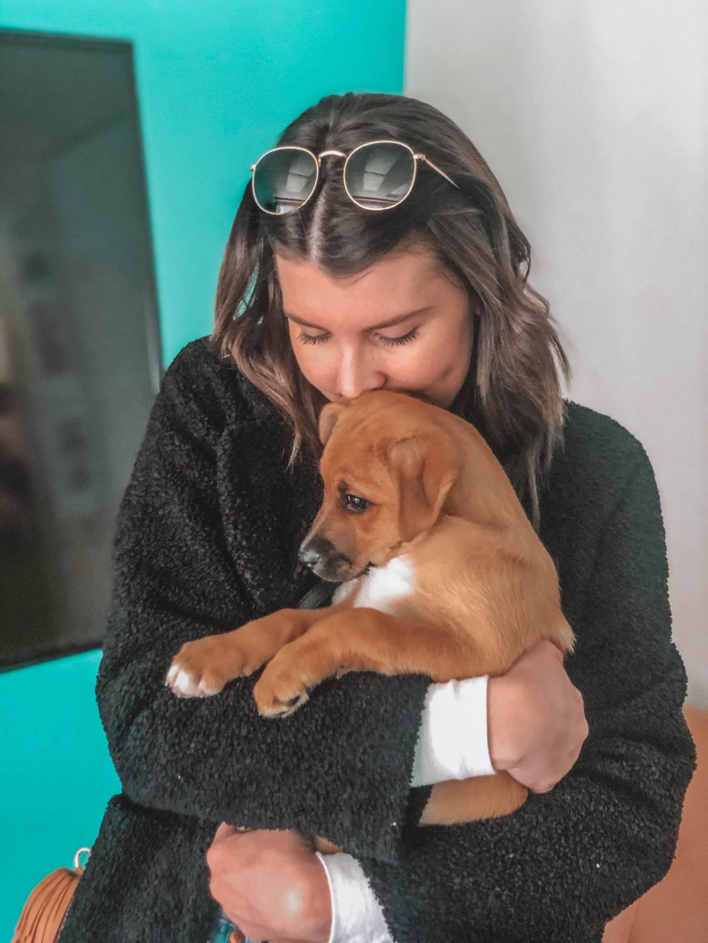 A photo of the author's wife hugging their new puppy.