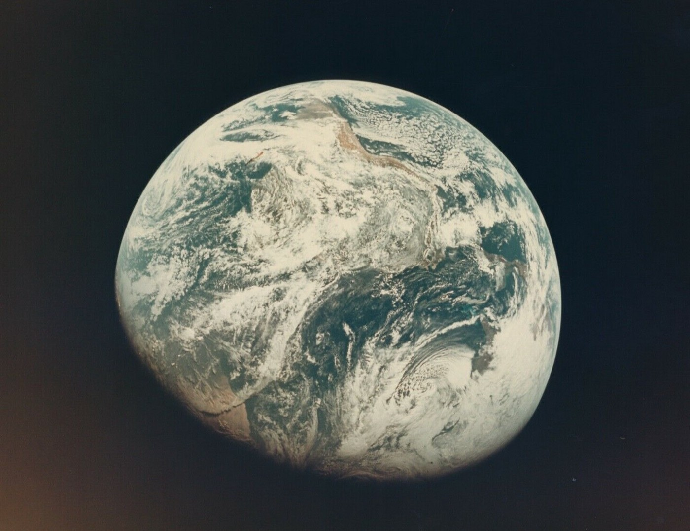 The first image taken by humans of the whole Earth. AS8–16–2593. William Anders, Apollo 8.