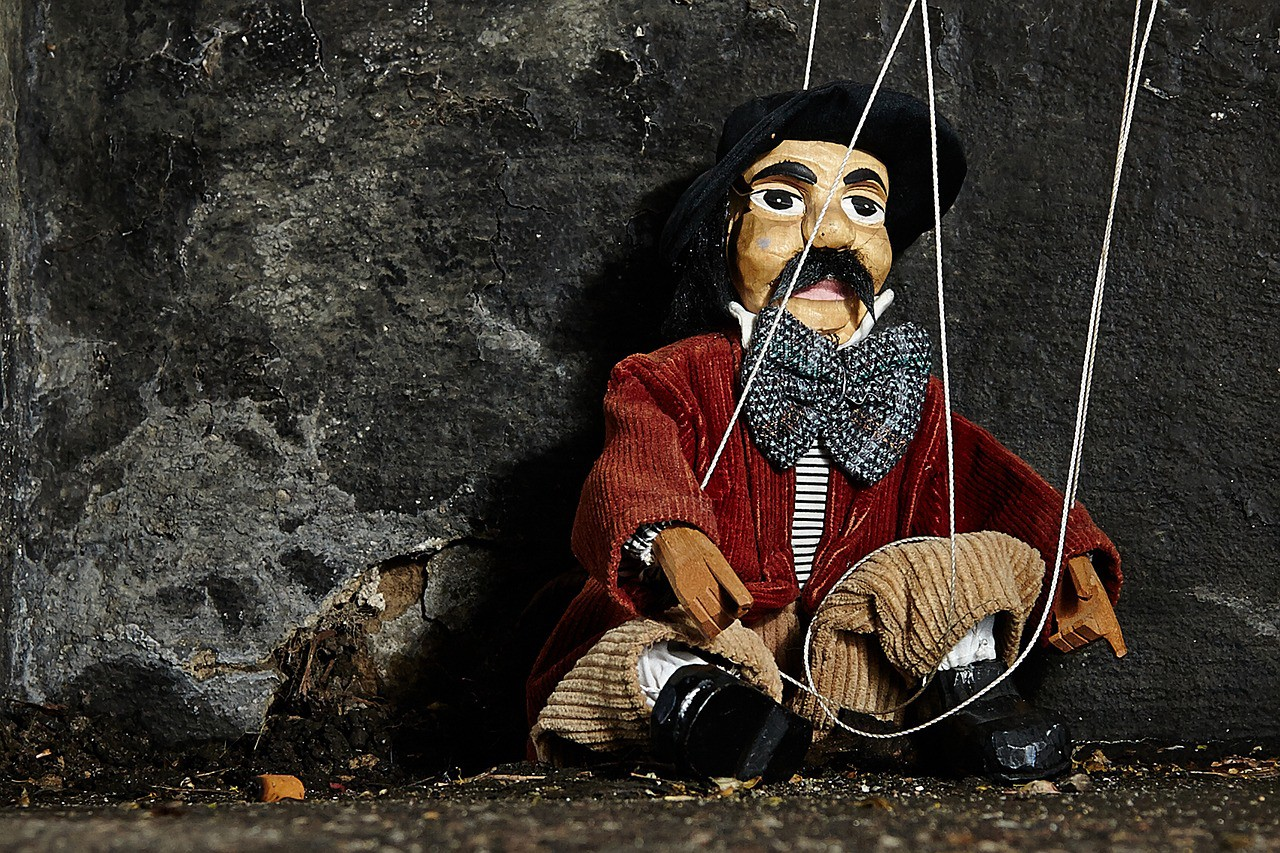 A picture of the marionette to reflect how this article is about using games and pulling strings to influence.
