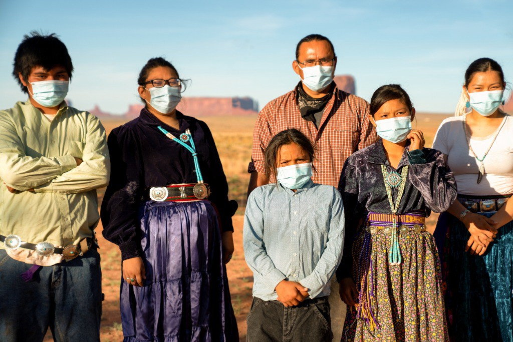 Native family wearing surgical masks