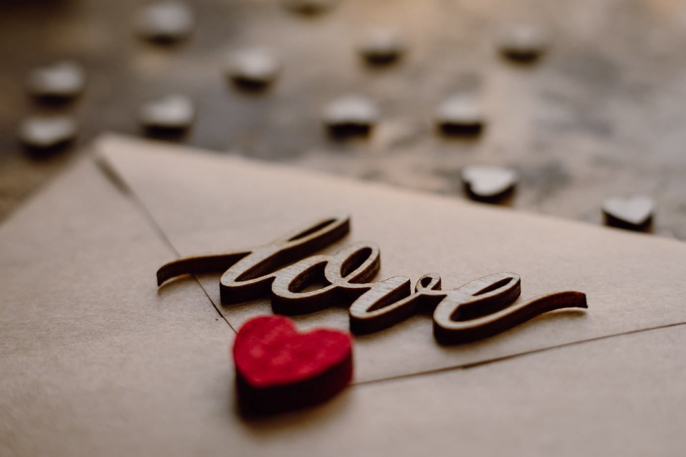 "Letter with the word ""love"" and a heart"
