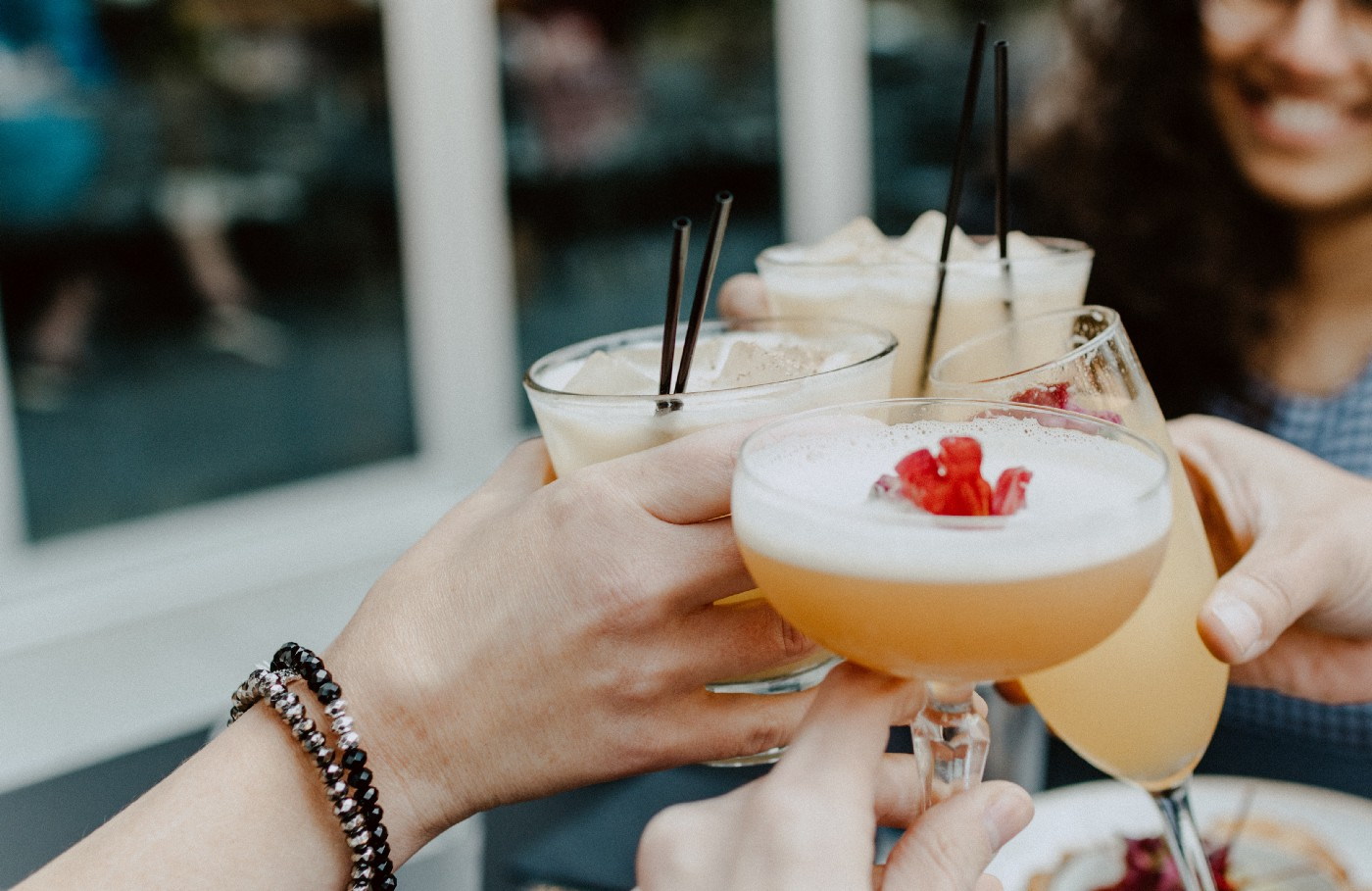 Photo of four women drinking cocktails together