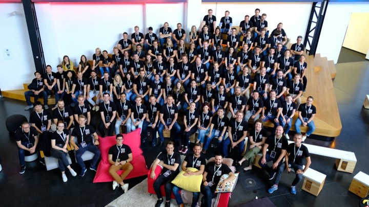 Top-shot of a large group of Porsche Digital employees during the first global company meeting in Ludwigsburg 2019