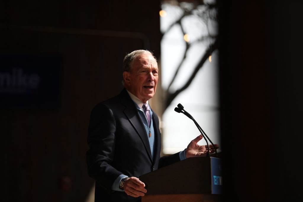 A photo of Mike Bloomberg speaking at a rally.