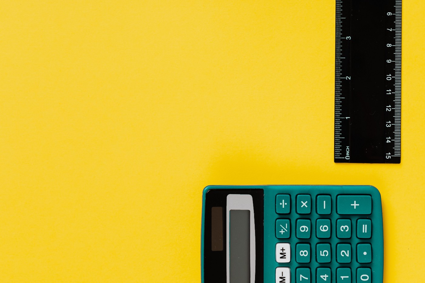 a calculator and a scale ruler