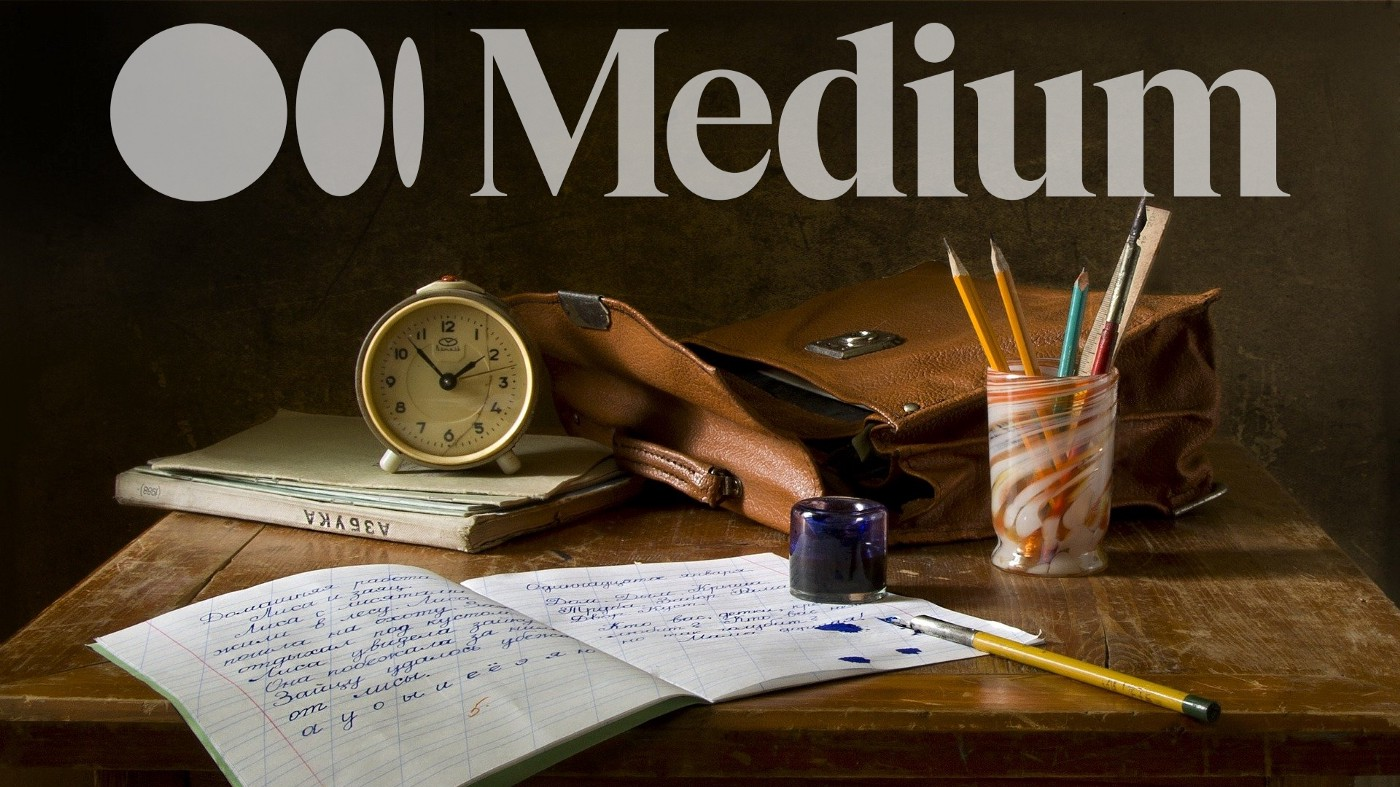 A desk with a leather bag, clock, notebook, ink, and pencil cup on it. The Medium logo sits overtop.