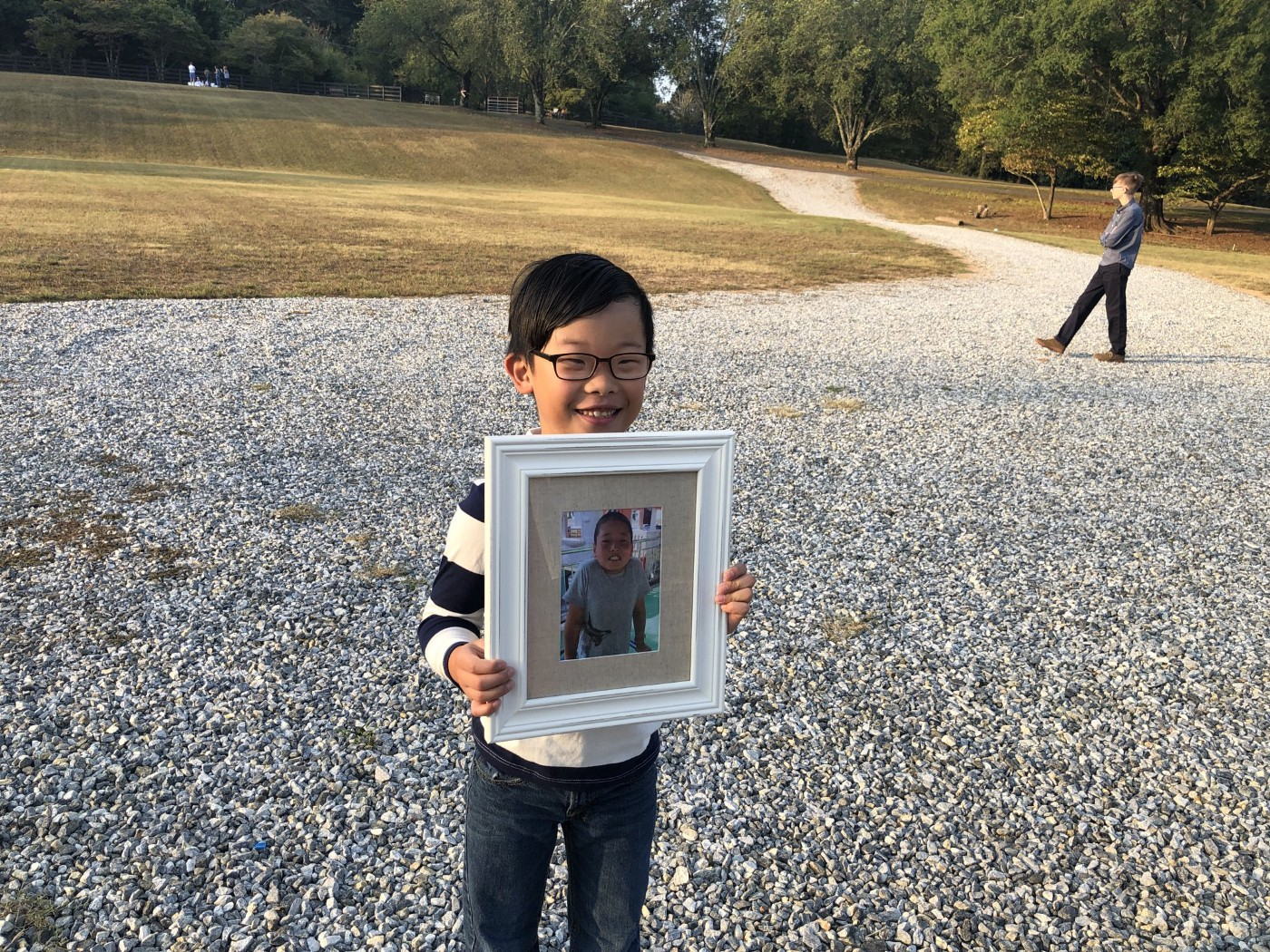 Our first adopted son holding a photo of our next adopted son